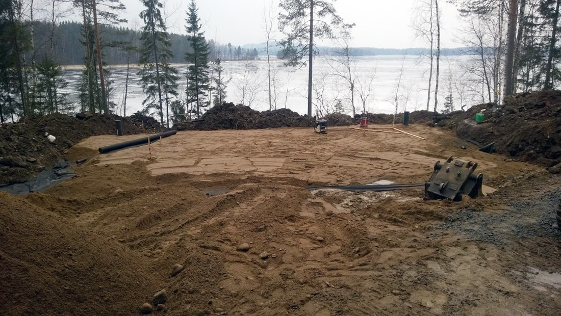 Pyramid House Finland site foundations construction lake forest studio void