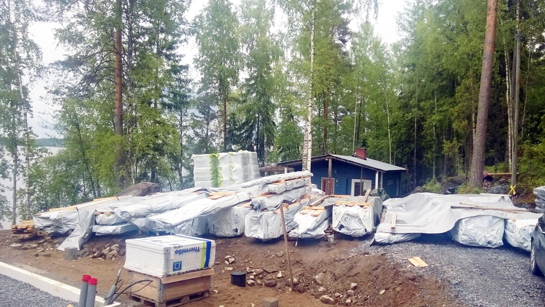 pyramid house finland construction site lake forest cabin