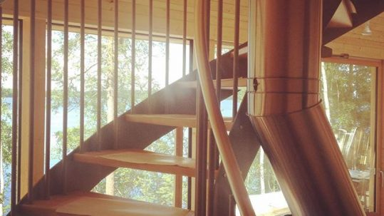 pyramid house Finland stairs interior design Paolo Caravello studio void