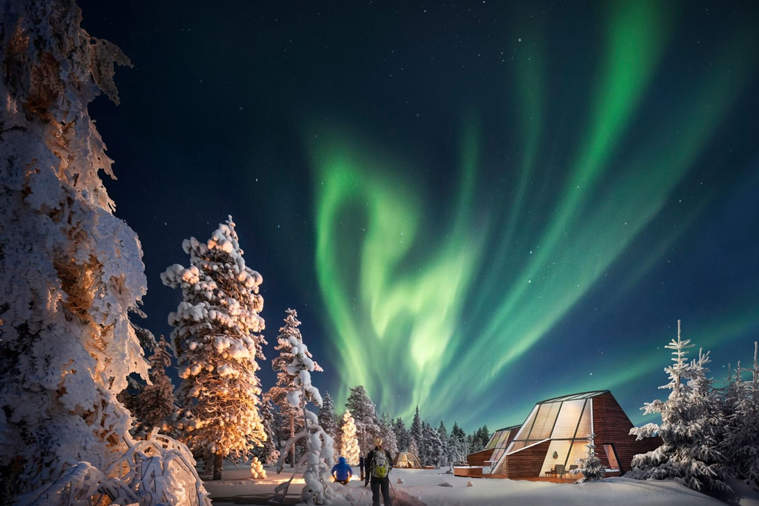 Snowman World Glass Resort in Santa Village Rovaniemi Lapland during winter skiing holiday