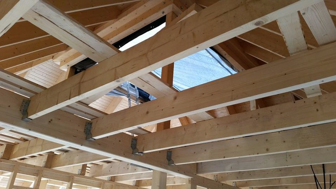 pyramid house finland construction site laminated wood beams